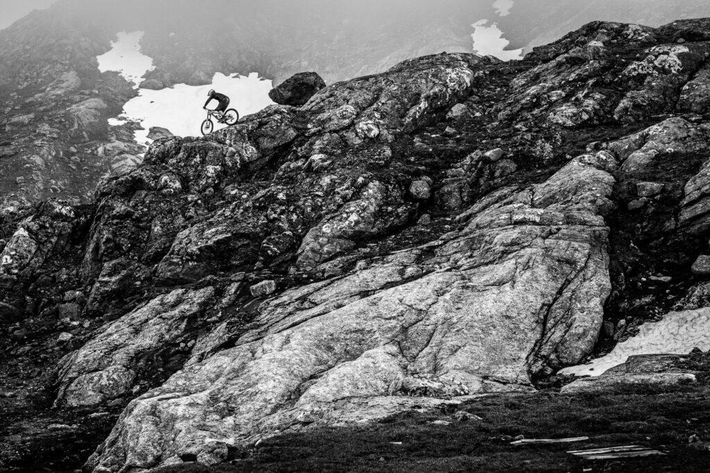 Mountain biker on rocky ridgeline, Åre, Sweden