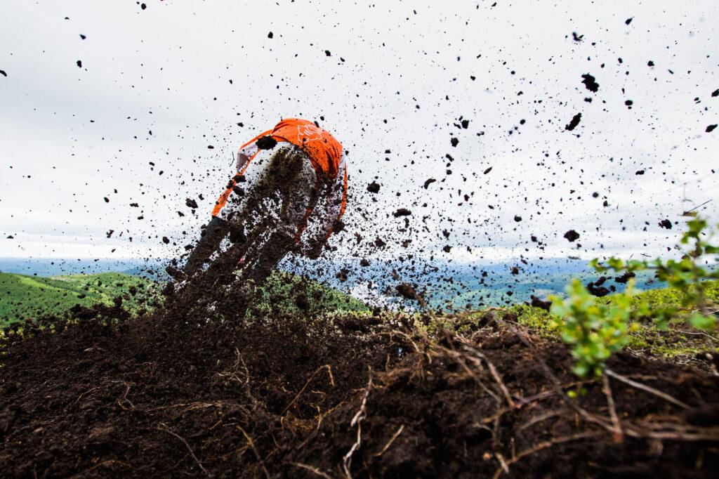 Mountain biker sprays mud, Åre, Sweden